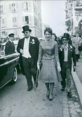 Queen Margarita being escorted while walking down the streets, 1962.