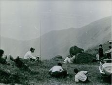 People camping on top of the mountains with their radios ready.
