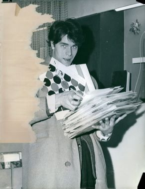 Laurent Terzieff holding a papers, 1959.