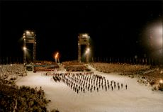 The Swedish squad marches into the opening of the 17th Olympic Winter Games