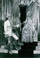 A photo of Princess Elizabeth II and princess Margareth participated in Royal Pantomime; Christmas 1941 top entertain parents and closed friends.