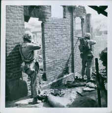 1950  Conflict in Korea: From the ruins of a building on Seoul's