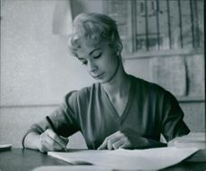Vintage photo of Michele Dimitri writing. Photo taken on February 25, 1959.