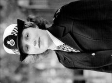 Portrait image of a female English police.