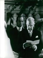 Prince Gustaf Adolf Oscar Fredrik Arthur Edmund, Duke of Västerbotten, reading a booklet during Baron Nils August and Princess Désirée, Baroness Silfverschiöld's wedding. 1964.