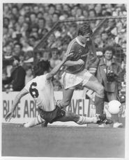 Colin Walsh and Steve Perryman fight for the ball