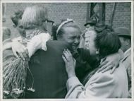 Girl embrace her parents after being rescued from catastrophe in Copenhagen, 1948.