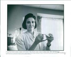 "A nurse (Paula Prentiss) prepares a sedative shot for Connie in a romantic comedy of mistaken identity, ""Mrs. Winterbourne""."