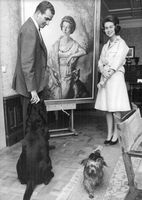 Juan Carlos and Sofia of Spain with dogs and painting.