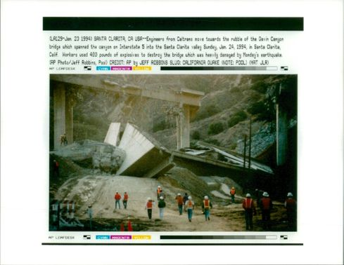 The 1994 Northridge earthquake USA:engineers from catrans move towards the rubble.