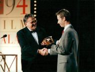 Gunnar Hellström handed a Golden Bagge to director Åke Sandgren for best director in the movie