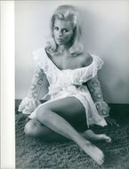 Pam Peterson striking a pose, one of those ravishing beauties, from the film
