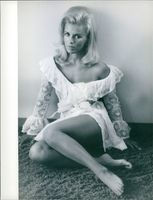 "Pam Peterson striking a pose, one of those ravishing beauties, from the film ""Where It's At""."