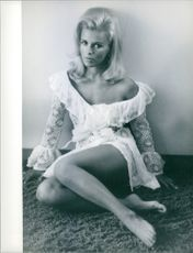 """Pam Peterson striking a pose, one of those ravishing beauties, from the film """"Where It's At""""."""