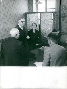 Former French President Charles de Gaulle seen with his wife Yvonne de Gaulle, talking to people