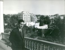 Mohammed Ben Bella standing on the balcony.