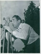 Jan Sigurd Baalsrud watching through telescope.
