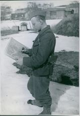 Swedish voluntary corp - Chris Stockholm marking the map. 1940