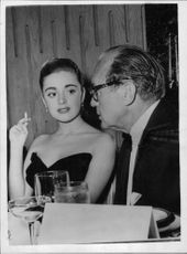 Anna Maria Alberghetti with a man, hearing.
