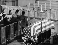 Coffin of Robert F. Kennedy, wrapped in US national flag.