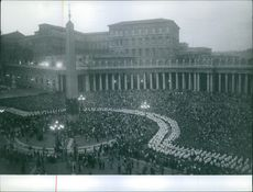 A crowded place during a celebration with Pope Pius XII.