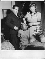 "Johan Jonatan ""Jussi"" Björling with his wife Anna-Lisa Bjorling, combing their son`s hair."