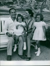 Silvana Mangano sitting on bench with family.