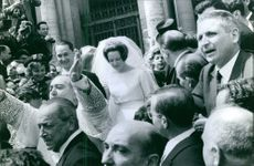 Carlos Hugo and his wife Princess Irene surrounded by people on their wedding day.
