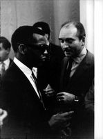 Ray Charles standing with a man.