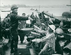 American soldier distributes soap to the people of Da Nang