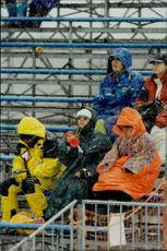 Winter Olympics in Nagano, spectators in rain