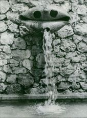 Stream of water falling down from the pipe.