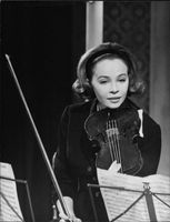 Leslie Caron playing on fiddle.