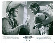 Jim Carrey and Ian McNeice star in a 1995 American comedy film,