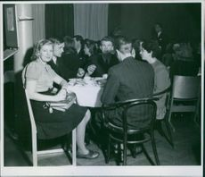 Swedish youths enjoying the night together and having a discussion.