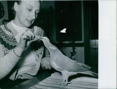 Pussi being fed by Miss Rasmussen. 1957