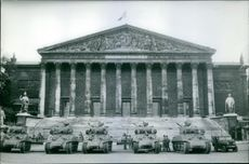 Military tanks in front of parliament building, the  National Assembly, in France.