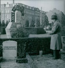 Man decorating a grave at Mosaic cemetery Malmö, Sweden. 1953