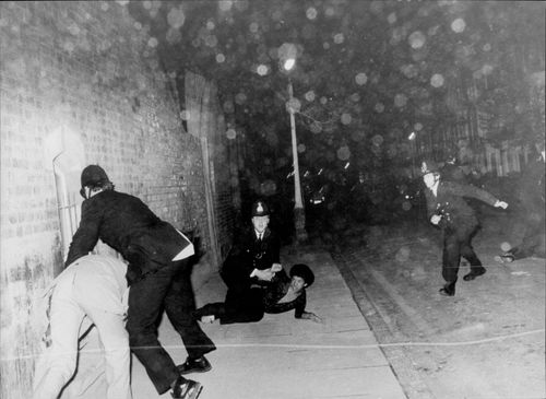Police officers intervene during a riot as a result of racial oppression in Brixton.