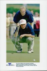 Danish golfer Tomas Bjoern together with his caddy.