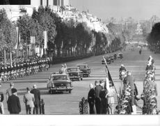 Mohammad Reza Shah Pahlavi waving towards the crowd during a parade in Paris.  Taken - 13 Oct. 1961