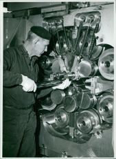 A man working on a factory machine.