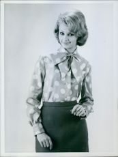 Woman standing and posing.