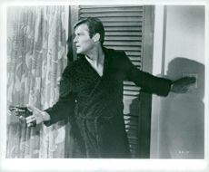"Roger Moore as Simon Templar in ""Helgonet""."