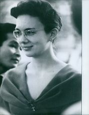 Nikita in spectacles and smiling. 1960