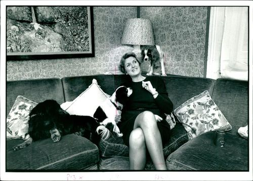 Mrs. Anne Heseltine sitting on a couch.