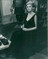 A photo of a Lady Kulukundis, OBE is a three-time Emmy Award-winning English actress, best known for her many television and film roles Susan Hampshire sitting at the side.