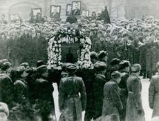A funeral ceremony in street.