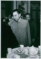 Photo of Zhou Enlai in a gathering.