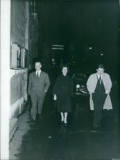 French General Jacques Massu is walking on the street with a unknown lady and a men. 1960